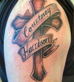 Wonderful looking cross tattoo