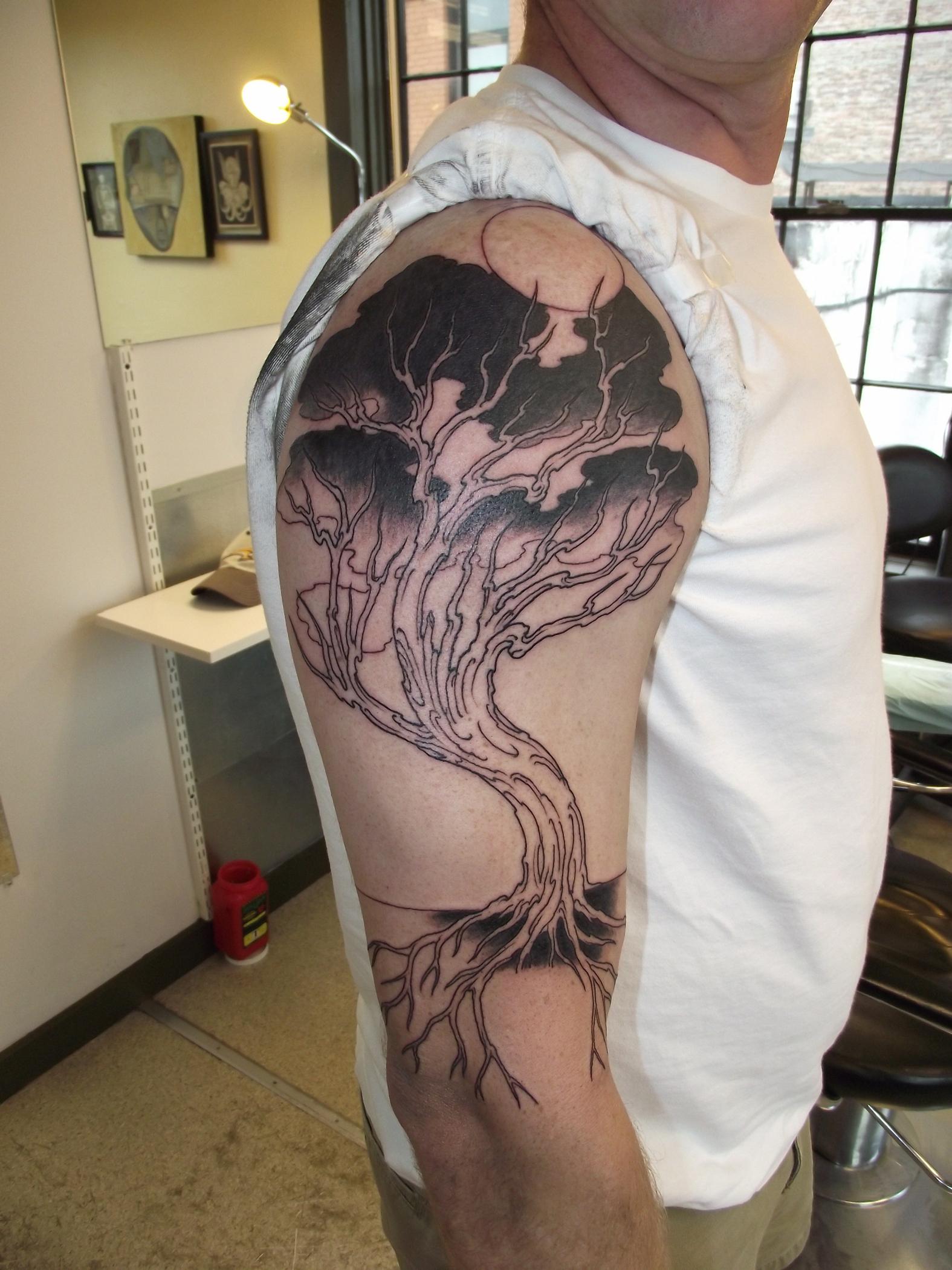 Gorgeous black trees tattoos