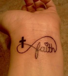 Wrist black cross tattoo