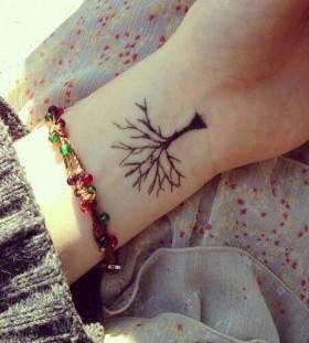 Wrist black tree tattoo