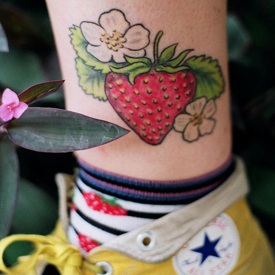 Yellow converse and strawberry tattoo