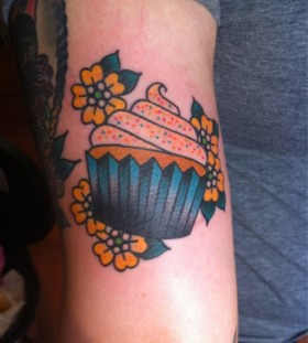 Yellow flowers and cake American Traditional Tattoo