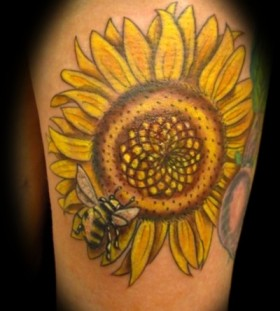 Yellow sunflower and bee tattoo on leg