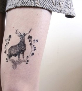 Floral black animal tattoo
