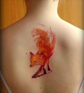 Girl's back fox tattoo