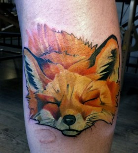 Oragne looking fox tattoo