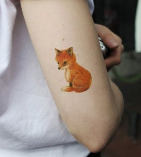 Orange small fox tattoo