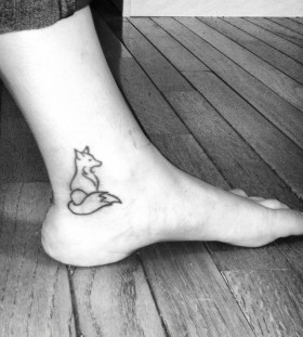 Small black foot fox tattoo