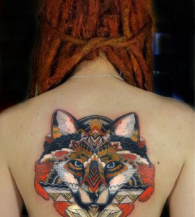 Women's back fox tattoo