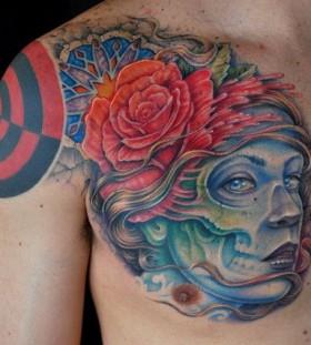 Blue girl face tattoo by Tattoo da Semana