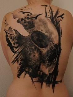 Skull and bird tattoo by Tattoo da Semana