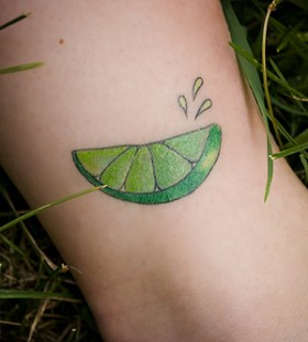Awesome lemon sliece tattoo