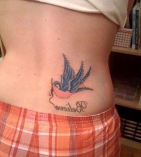 Blue bird girl's hip tattoo