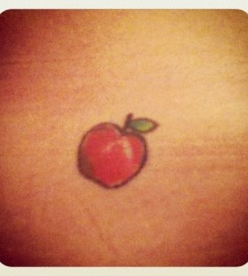 Green leaf apple tattoo