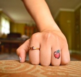Knuckle finger apple tattoo