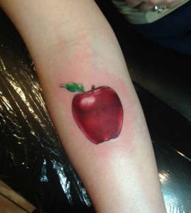 Looking great red apple tattoo