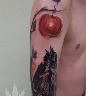 Men's shoulder apple tattoo
