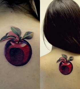 Women's back apple tattoo