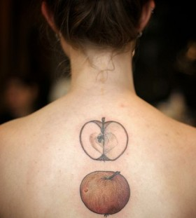 Women's back lovely black apple tattoo