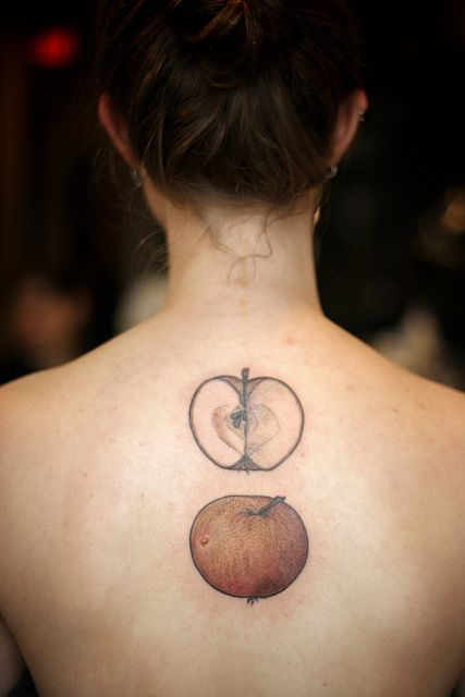 Red and green apple tattoos