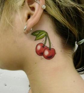 Women's ear cherry tattoo