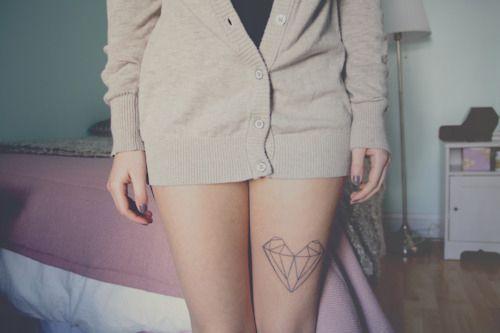 Black simple diamond tattoo on leg