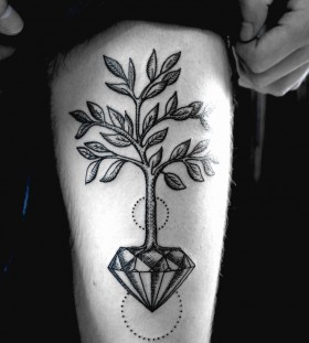 Black tree diamond tattoo on leg