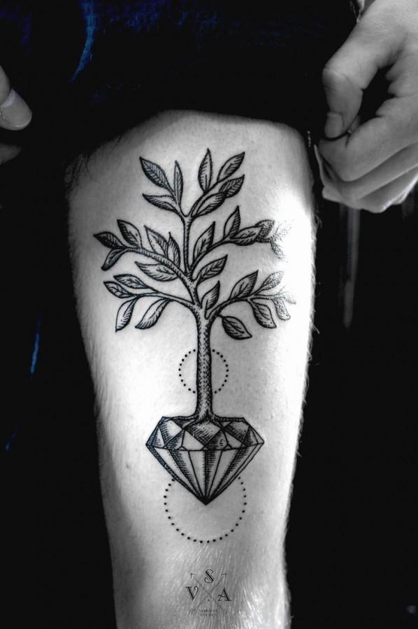 Black tree diamond tattoo on leg