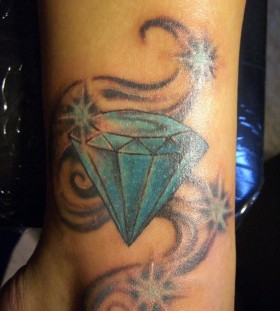 Blue heart diamond tattoo on leg