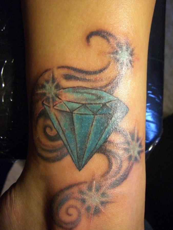 Blue heart diamond tattoo on leg