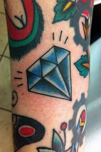 Cool looking blue diamond tattoo on leg