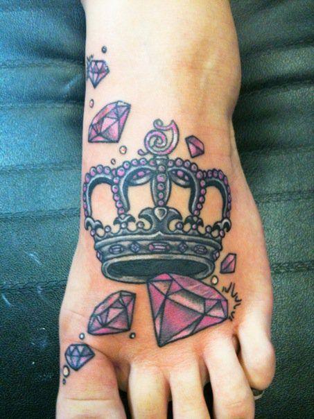 Crown and purple diamond tattoo on leg