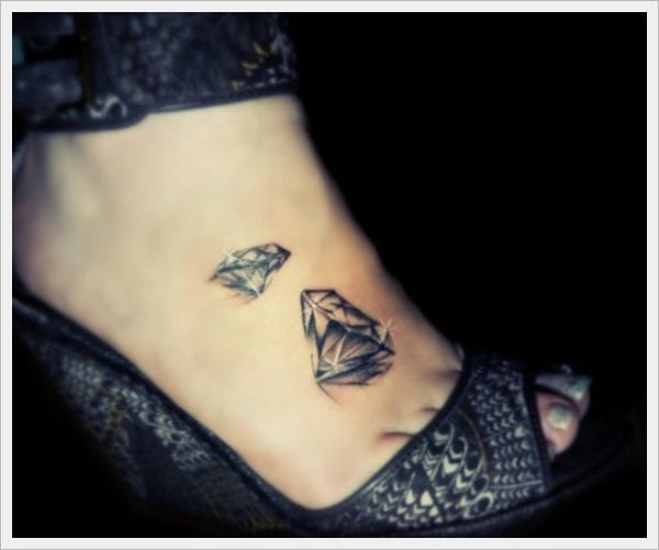 Girl's high-heels and diamond tattoo on leg