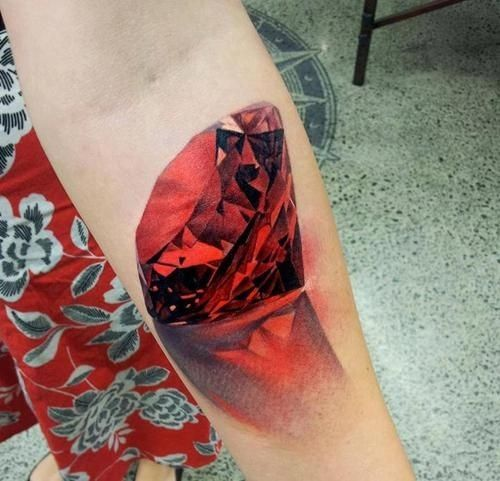Incredible color diamond tattoo on leg