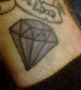Purple black diamond tattoo on leg