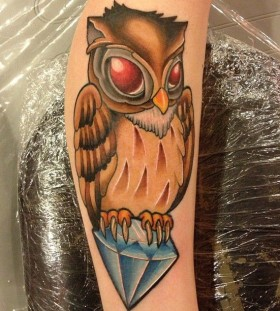 Simple owl diamond tattoo on leg