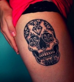 Skull and black diamond tattoo on leg