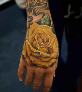 Amazing arm's yellow rose tatoo