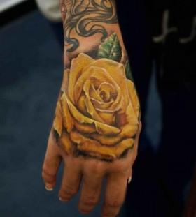 Amazing arm's yellow rose tatoo