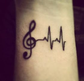 Awesome looking music note tattoo