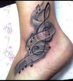 Black and white music note tattoo