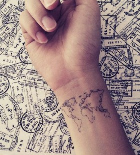 Black conturus on wrist map tattoo