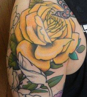 Black ornaments and yellow rose tatoo
