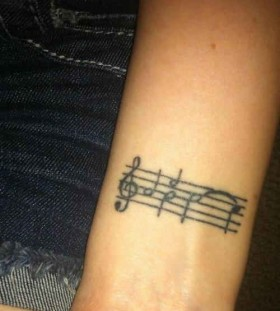 Black simple music note tattoo