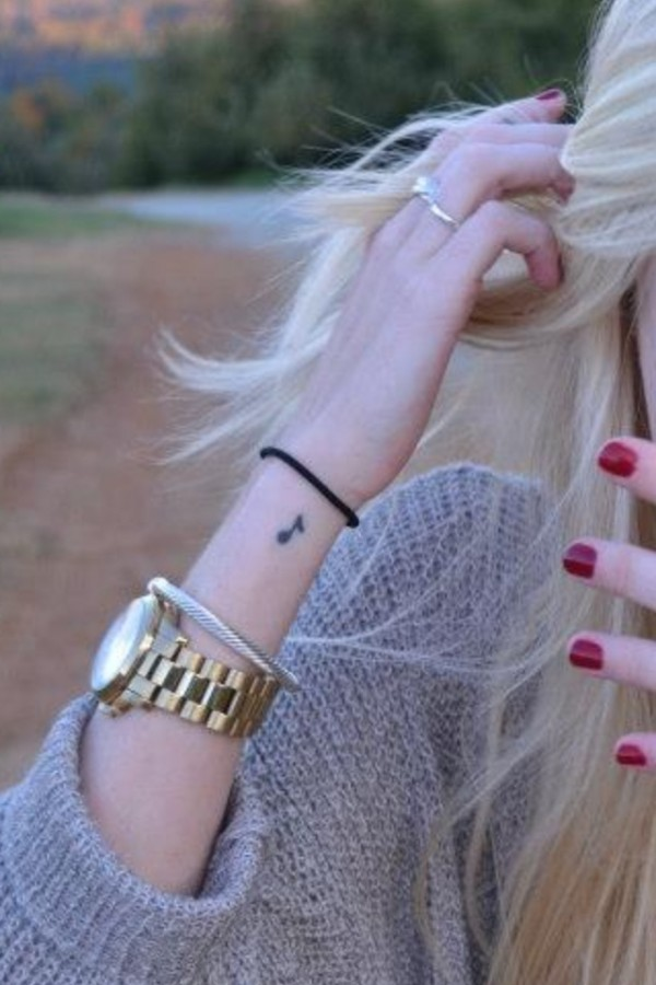 Blonde girl's music note tattoo