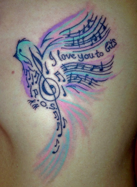 Colorful bird's and music note tattoo