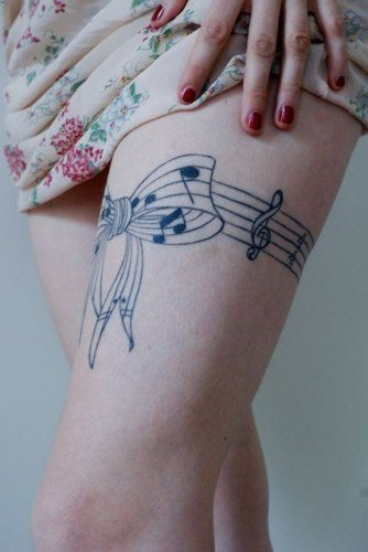 Cool leg's music note tattoo