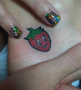 Cute little strawberry tattoo