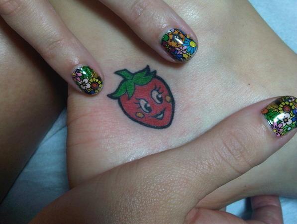 Cute little strawberry tattoo