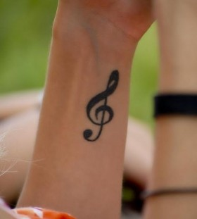 Girl's arm's music note tattoo